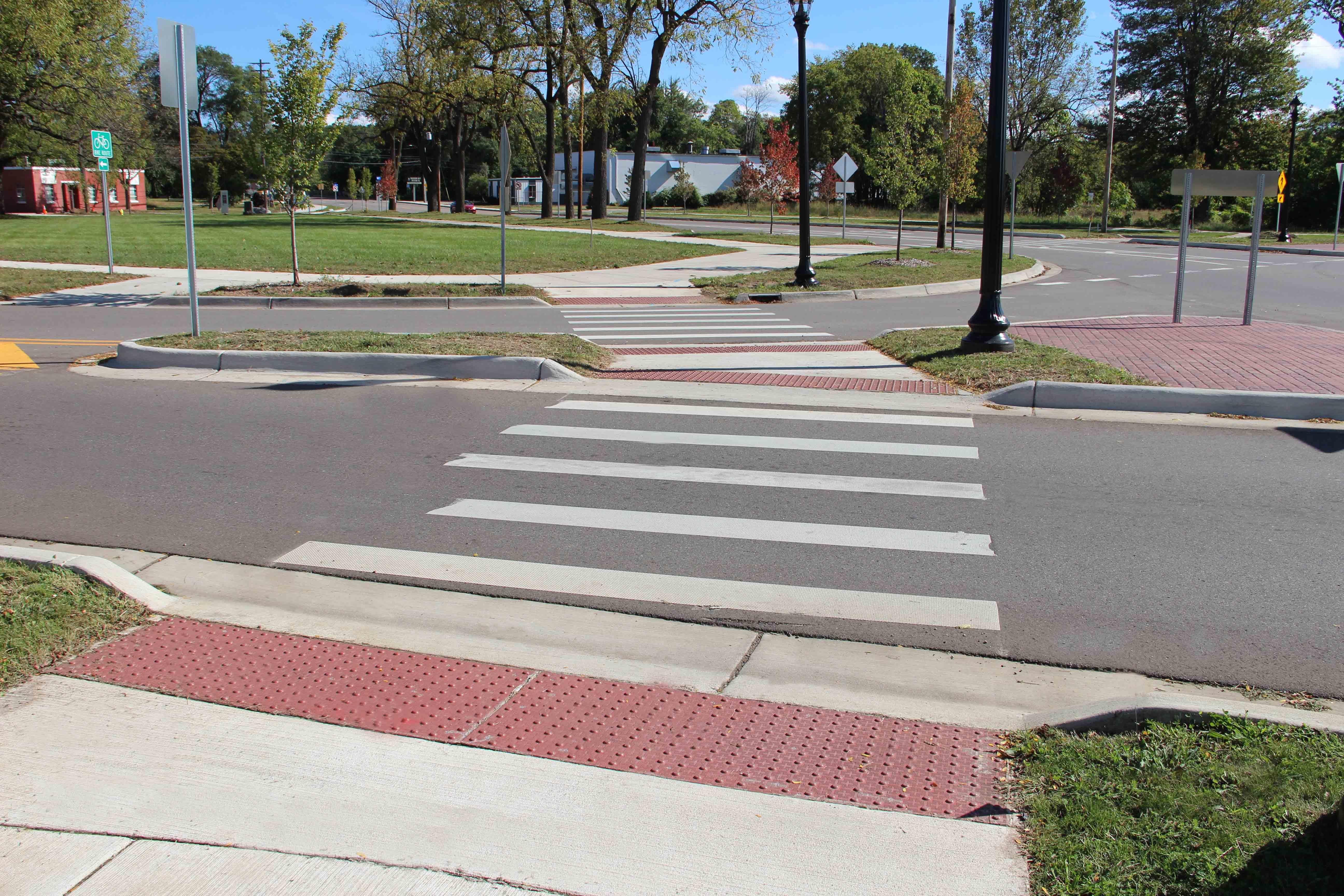 Kalamazoo Roundabout two lanes sidewalk pedestrian crossing view