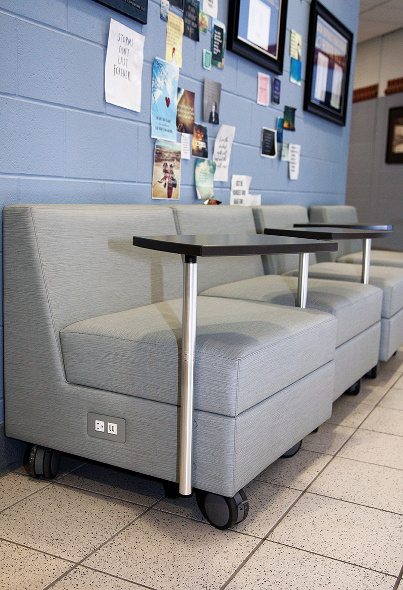 New Buffalo Schools loose furnishings grey lounge chairs with tablet arms