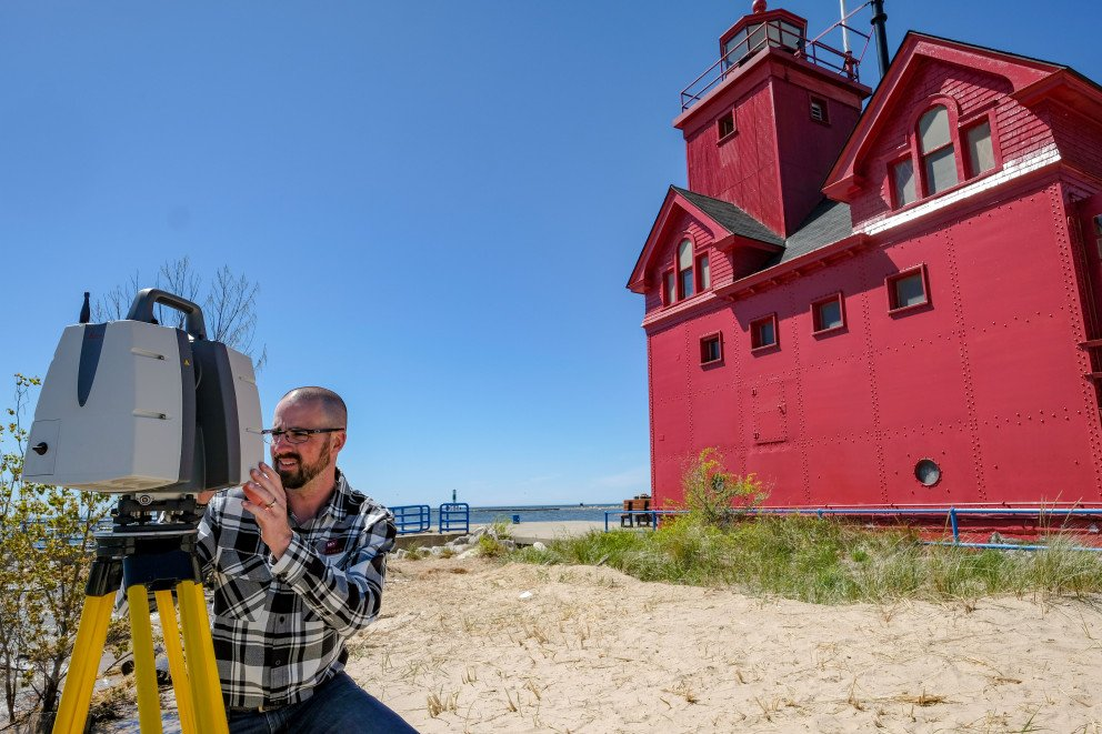 Holland Lighthouse with beach lake scanner and Wightman employee
