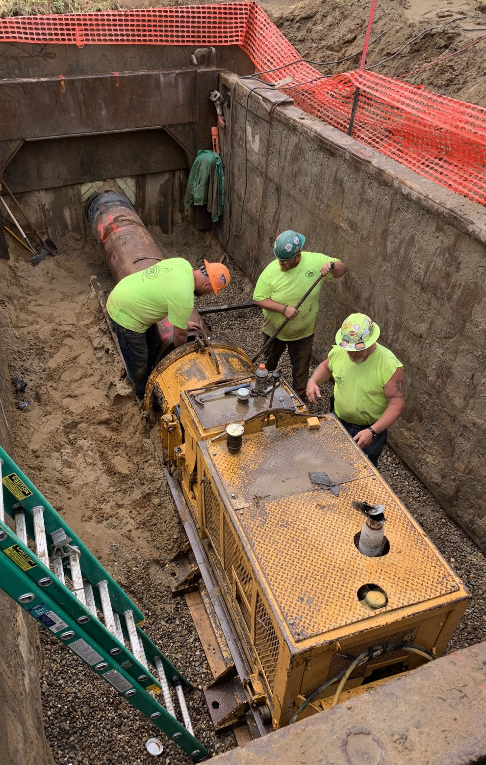 Dunham Lift Station Workers Assembling Equipment
