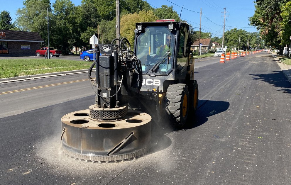 Coring Pavement to Adjust Manholes to Finished Surface