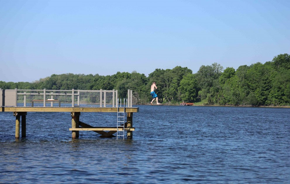 Jumping off the pier into Stone Lake